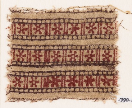 Textile fragment with bands of rosettes and lines