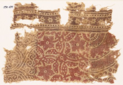 Textile fragment with plants and rosettes
