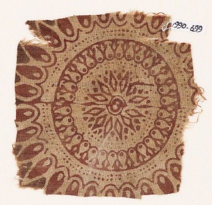Textile fragment with an elaborate rosette, circles, and petals