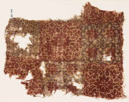 Textile fragment with quatrefoils, linked crosses, and rosettes
