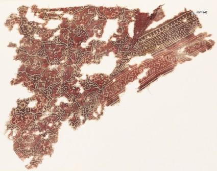 Textile fragment with interlacing tendrils and quatrefoils
