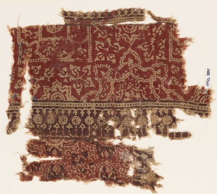 Textile fragment with half-medallions, squares, and plants