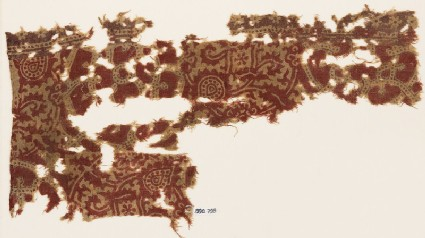 Textile fragment with interlocking circles and interlace