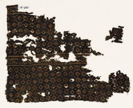 Two textile fragments with rosettes, lobed squares, and dots