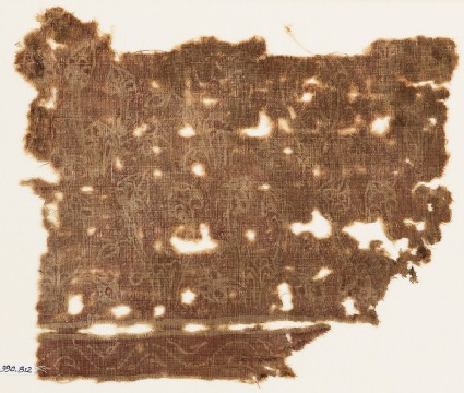 Textile fragment with flowering plants