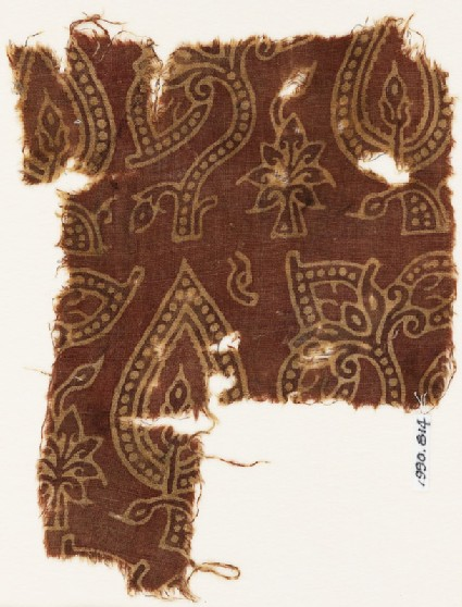 Textile fragment with stylized, dotted leaves