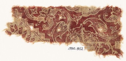 Textile fragment with swirling tendrils and flower-heads