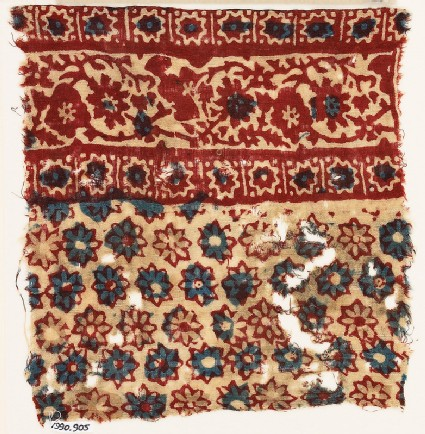 Textile fragment with rosettes and vine