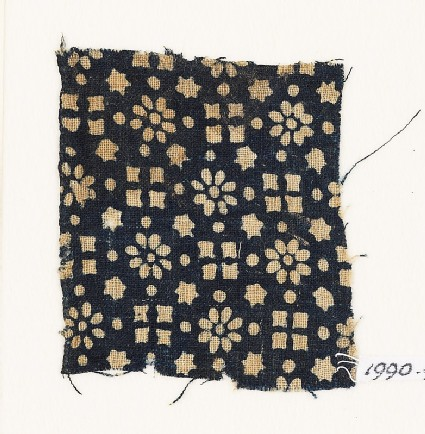 Textile fragment with rosettes, stars, and squares