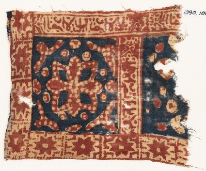 Textile fragment with square, a flower, stars, and Arabic inscription