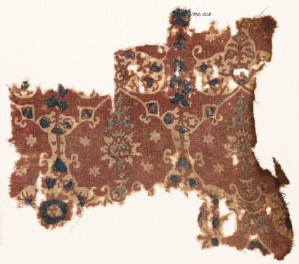 Textile fragment with lobed shapes, possibly leaves