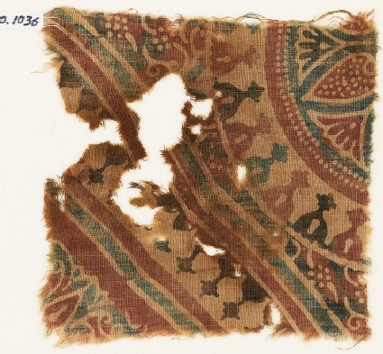 Textile fragment with stylized bodhi leaves, rosettes, and tendrils