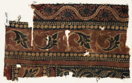 Textile fragment with leaves and dotted vine