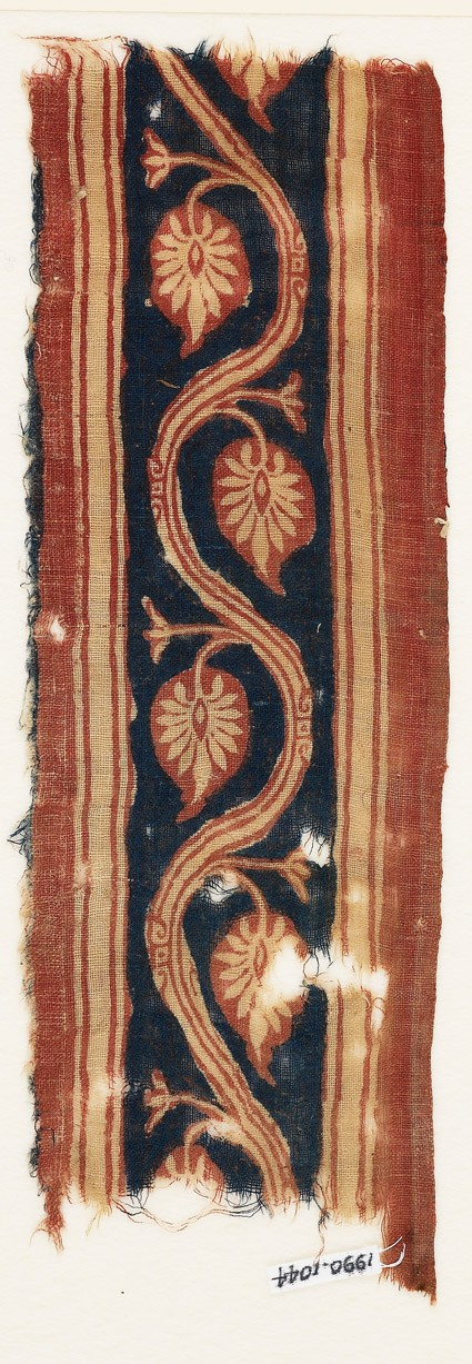 Textile fragment with vine and palmette leaves