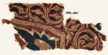 Textile fragment with tendrils, fruit, and leaves