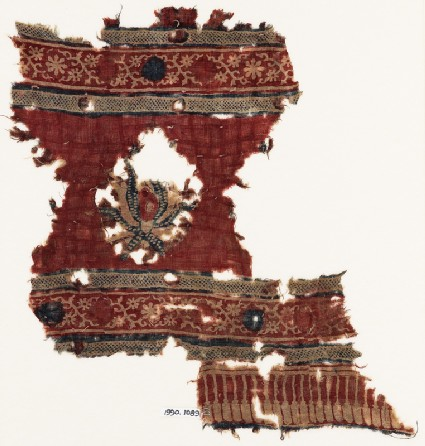 Textile fragment with large flower and crossed tendrils