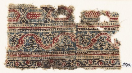 Textile fragment with bands of elongated hexagons and vines