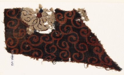 Textile fragment with tendrils and flower