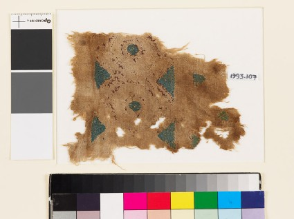 Textile fragment with linked hexagons, circles, and triangles