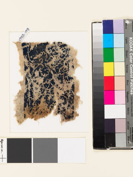 Textile fragment with floral trefoil shapes and leaves