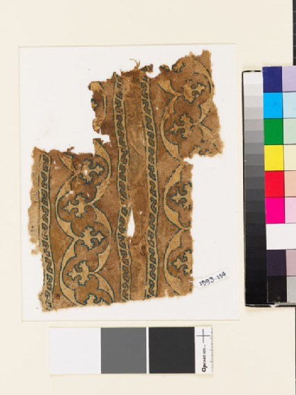 Textile fragment with bands of curving lines and floral trefoils