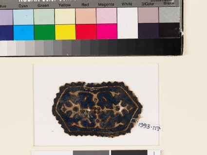 Textile fragment with hexagon, two palmettes, and leaves