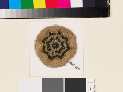 Textile fragment with eight-pointed star, possibly a jar cover
