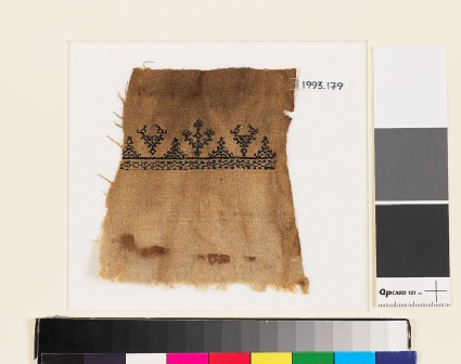 Textile fragment with stylized birds and trees