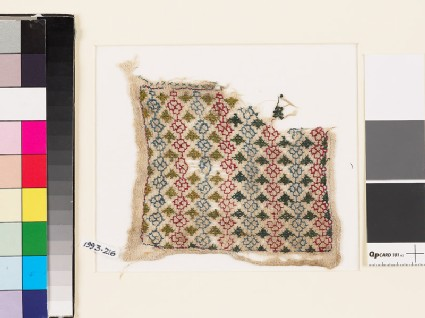 Textile fragment with linked rosettes and leaves