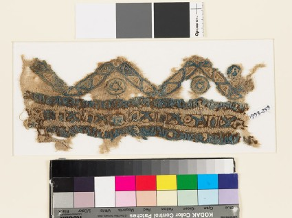 Textile fragment with chevrons, circles, and stars