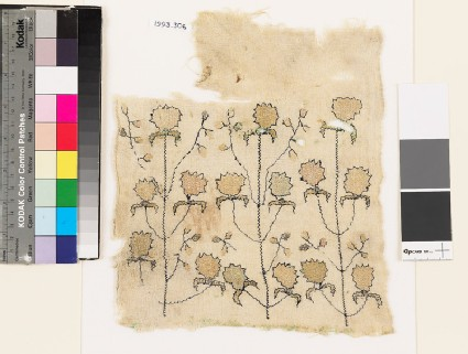 Textile fragment with stylized flowers and leaves