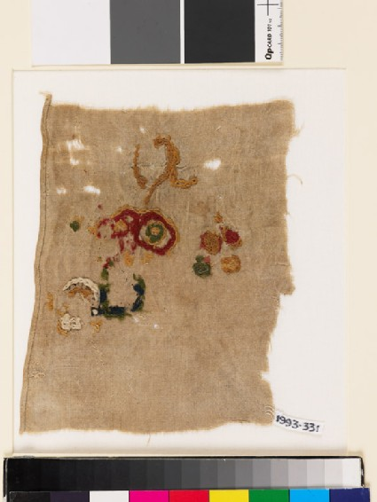 Textile fragment with incomplete floral shapes