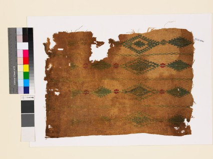 Textile fragment with linked diamond-shaped medallions and lattice
