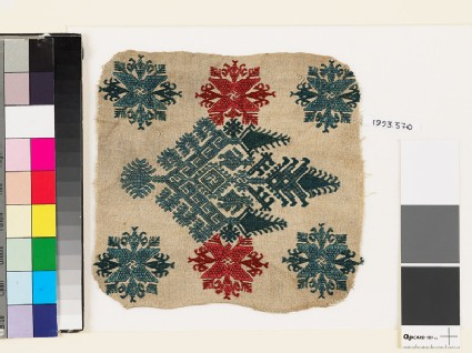 Textile fragment with an elaborate medallion, trees, birds, and flowers