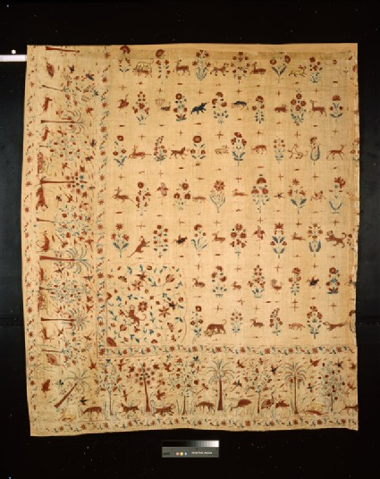 Quarter of a coverlet with animals, birds, flowers, and insects among trees