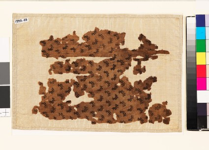 Textile fragment with stylized birds