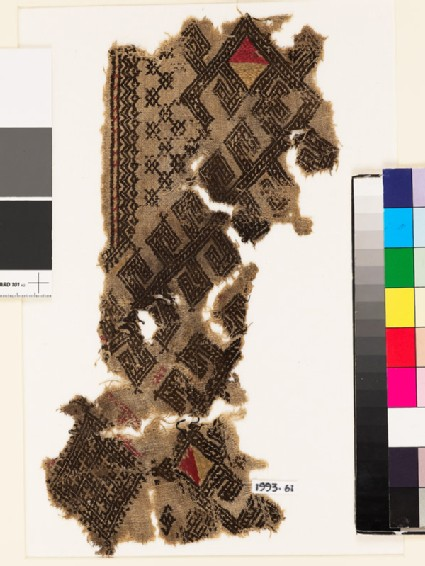 Textile fragment from the neck of a garment with hooks and diamond-shapes