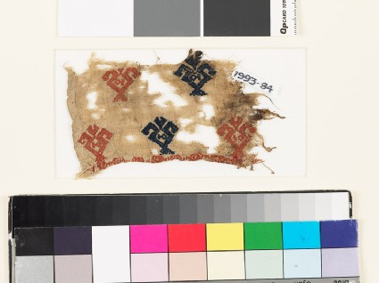 Textile fragment with floral shapes and possibly fish
