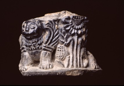 Fragmentary object, possibly the pedestal or foot of a pot, carved with figures of winged lions and lotus