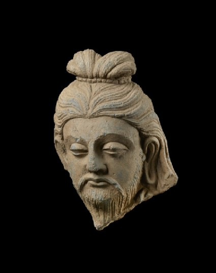Head of a bearded rishi or sage