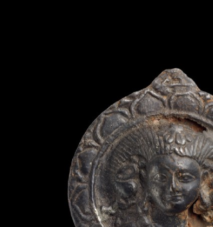 Roundel with relief bust figure wearing horned headdress