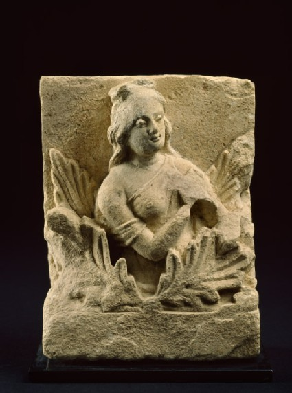 Frieze fragment depicting a female attendant among acanthus leaves
