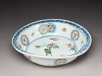 Dish with a bird on a flowering branch