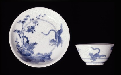 Saucer with leaping tiger