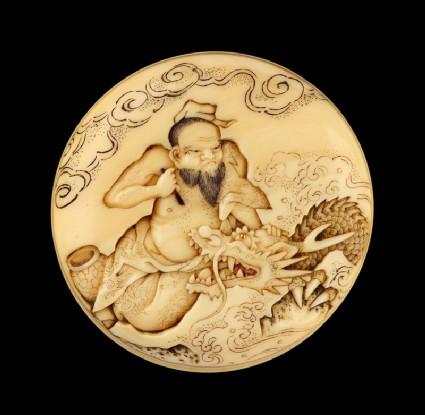 Manjū netsuke depicting the Daoist immortal Bashikō performing acupuncture on a dragon