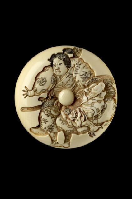 Manjū netsuke depicting Minamoto Yoshitsune practising martial arts with a tengu demon