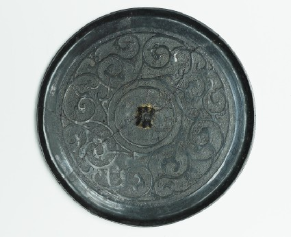 Ritual mirror with scrolling interlace decoration