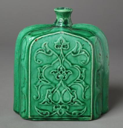 Bottle with vegetal design