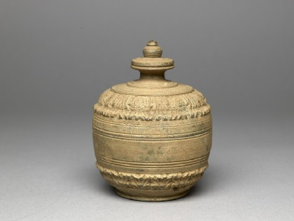 Lidded reliquary containing votive offerings