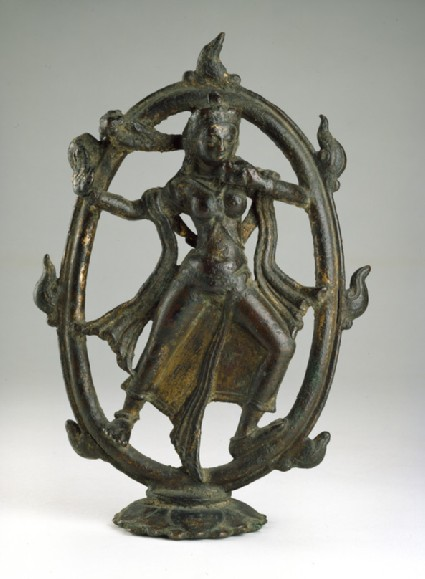 Figure of Devi dancing in a ring of fire